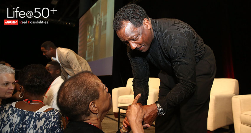 Donnie Simpson greeting fans who attended Life After 50+ AARP event