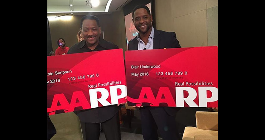 Donnie Simpson and Blair Underwood holding AARP membership cards