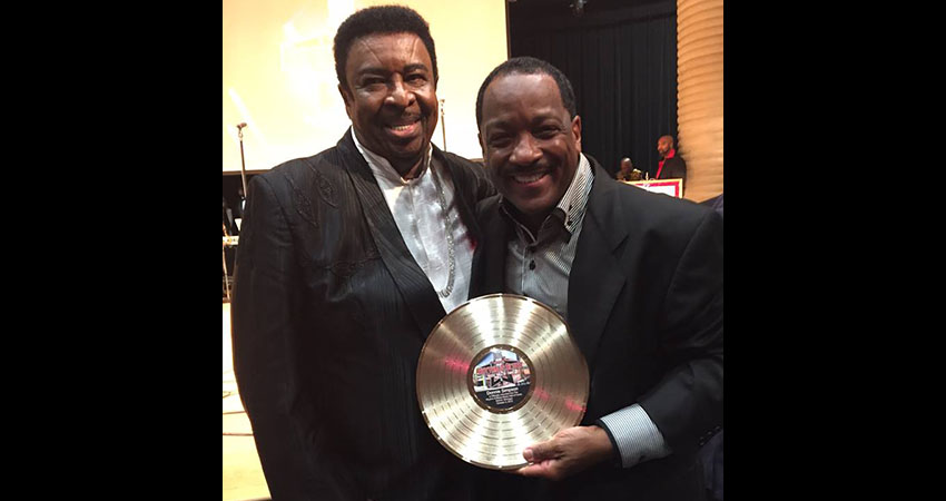 Donnie Simpson with Dennis Edwards holding the national R&B Music Hall of Fame award.