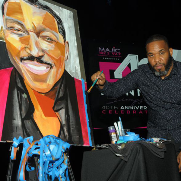 Artist with painting of Donnie.